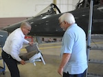 Jimmy Pulido, left, 12th Flying Training Wing maintenance egress supervisor and Michael LoBue, egress technician, prepare to install a foldable seat on a T-38 aircraft, April 17, 2017.