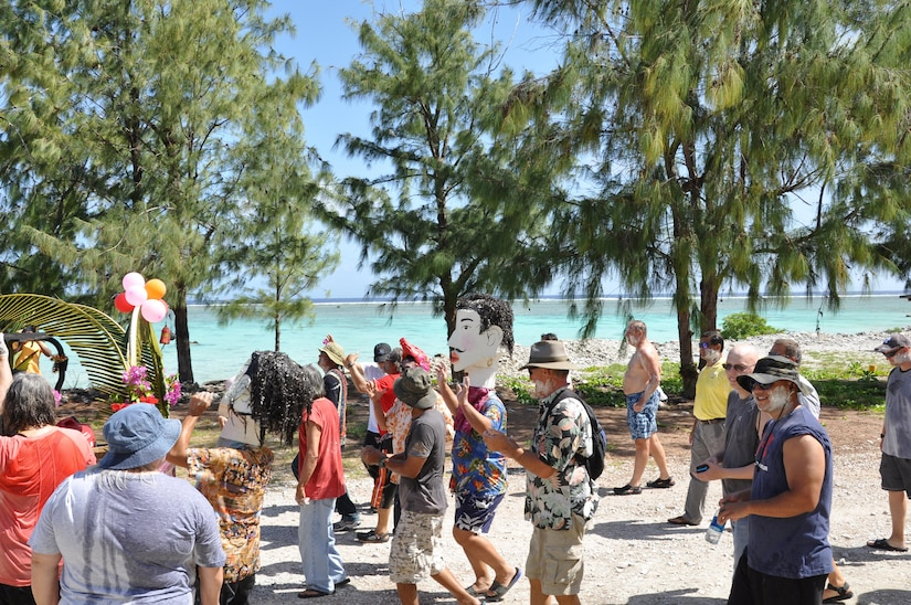Wake Atoll residents, made up of only 100 Air Force members and American and Thai contractors, march during a parade to celebrate the Thai Songkran Water Festival April 16, 2017. The water festival is part of the Thai New Year, Songkran, and is celebrated throughout Thailand each year on April 13th. Wake Atoll is an Air Force installation and airfield located in the Pacific Ocean halfway between Hawaii and The Philippines and nearly 4,300 miles from Thailand. Wake is a U.S. Territory managed by the Pacific Air Forces Regional Support Center located at Joint Base Elmendorf-Richardson, Anchorage, Alaska. Wake Island Airfield has a 10,000-foot runway and serves as a trans-Pacific refueling stop for military aircraft in addition to supporting Missile Defense Agency test activities.
