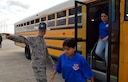 John Jay High School Air Force Junior Reserve Officer Training Corp students are directed off the bus by Tech. Sgt. Jason Hernandez, a 433rd Training Squadron military training instructor, April 19, 2017 at Joint Base San Antonio-Lackland, Texas. The students toured the engine, and structural engineering shops at the 433rd Airlift Wing and also saw a Military Working Dog demonstration at the 802nd Security Force Squadron. (U.S. Air Force photo by Tech. Sgt. Carlos J. Trevino) (released)