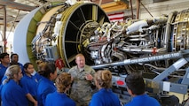 Staff Sgt. Shane Smith, a 433rd Maintenance Squadron jet engine technician, talks about the functions of a jet engine for a C-5M Super Galaxy and his experience as an Air Force Reservist to Air Force Junior Reserve Officer Training Corp students from John Jay High April 19, 2017 at Joint Base San Antonio-Lackland, Texas. The students toured engine and structural engineering shops at the 433rd Airlift Wing and also saw a Military Working Dog demonstration at the 802nd Security Force Squadron. (U.S. Air Force photo by Tech. Sgt. Carlos J. Trevino) (released)