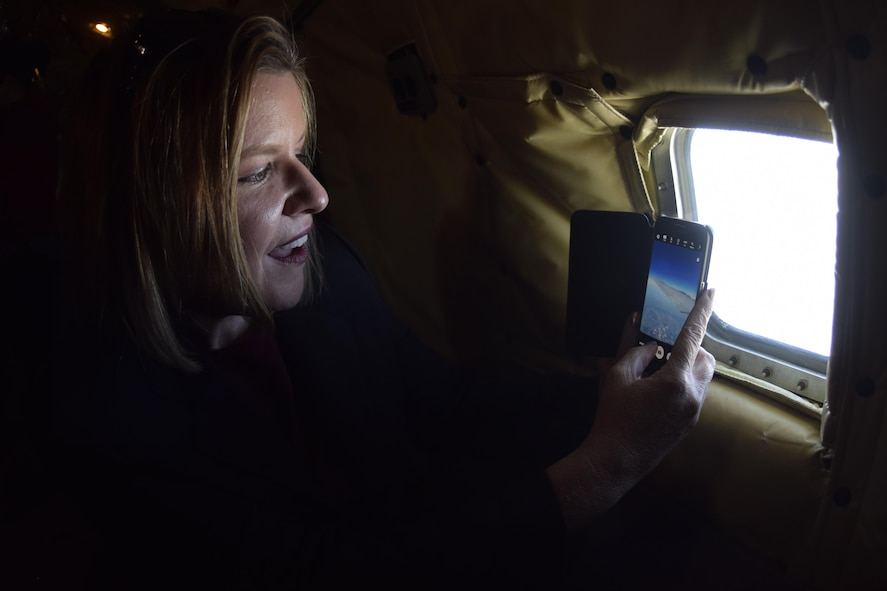 Debra Toufel, University of Oklahoma Price College of Business director of public private partnerships, and member of the Tinker Air Force Base Honorary Commander's 2017 Class takes a photo through the fuselage window of a KC-135R Stratotanker during a local training flight April 6, 2017, from Tinker Air Force Base, Oklahoma. The Honorary Commander's learned about the mission of the 507th Air Refueling Wing, Air Force Reserve Command, during an air refueling mission with F-16 Fighting Falcons of the 138th Fighter Wing, Oklahoma Air National Guard. (U.S. Air Force photo/Greg L. Davis)