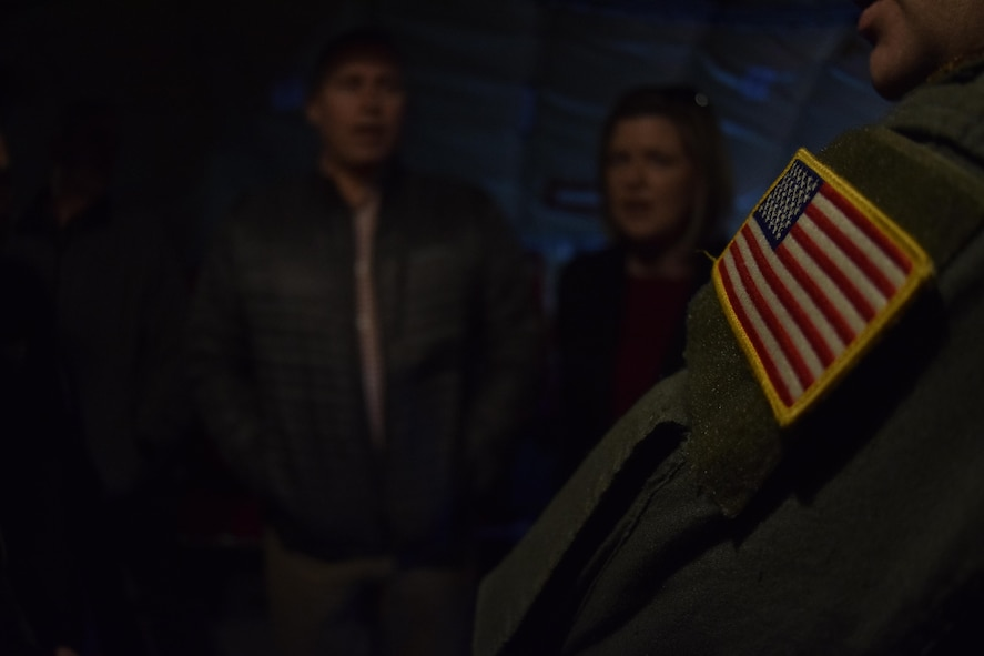 the American flag is in sharp focus on the shoulder of a member of the 507th Air Refueling Wing, Air Force Reserve Command, during a mission briefing aboard a KC-135R Stratotanker for the Tinker Air Force Base Honorary Commander's 2017 Class April 6, 2017, Tinker Air Force Base, Oklahoma. The Honorary Commander's learned about the KC-135R Stratotanker's mission during an air refueling mission with F-16s of the 138th Fighter Wing, Oklahoma Air National Guard. (U.S. Air Force photo/Greg L. Davis)