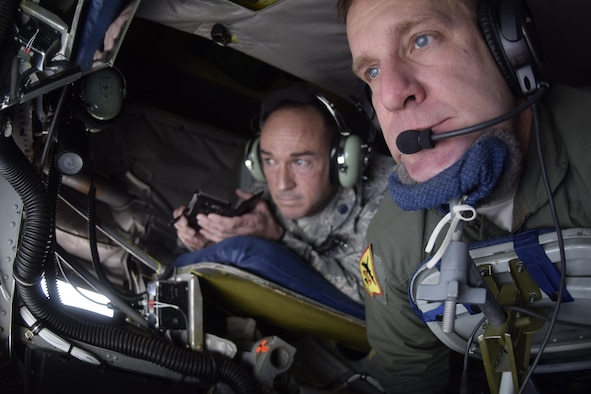 Master Sgt. Charles Danten, 465th Air Refueling Squadron, 507th Air Refueling Wing, Air Force Reserve Command, looks down on F-16s during a air refueling mission while Lt. Col. Lance Winner, 513th Air Control Group deputy commander, watches the action in the background April 6, 2017, from Tinker Air Force Base, Oklahoma. The 507th ARW conducted a local training flight with members of the Tinker Air Force Base Honorary Commander's 2017 Class to learn about the KC-135R Stratotanker's mission during an air refueling mission with F-16s of the 138th Fighter Wing, Oklahoma Air National Guard. (U.S. Air Force photo/Greg L. Davis)
