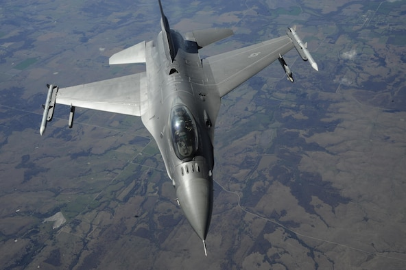 F-16C Fighting Falcon of the 138th Fighter Wing, Oklahoma Air National Guard, drops away from a KC-135R Stratotanker of the 507th Air Refueling Wing, Air Force Reserve Command, during a training flight April 6, 2017, over Missouri. The F-16 has the HAVE GLAS radar reduction coating applied giving it a slightly different appearance to the more commonly seen paint scheme of previous years. The KC-135R flew from Tinker Air Force Base, Oklahoma while the F-16 flew from Tulsa Air National Guard Base, Oklahoma. (U.S. Air Force photo/Greg L. Davis)