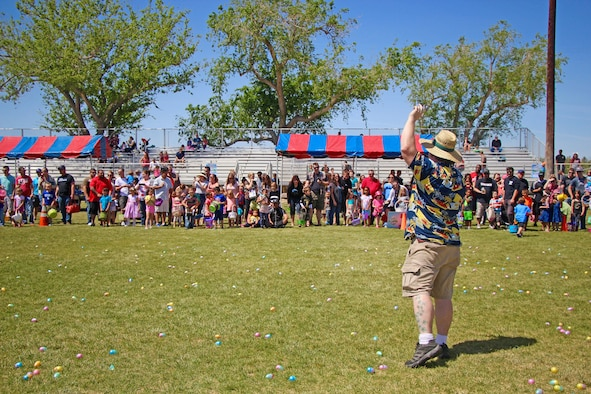 Edison Ruland, 412th FSS Community Activities director, prepares to give the starting order to a group of children to begin their Easter egg hunt at Wings and Roberts Fields April 15. A total of 8,000 prize-filled eggs were collected. (U.S. Air Force photo by Kayla Fagan)
