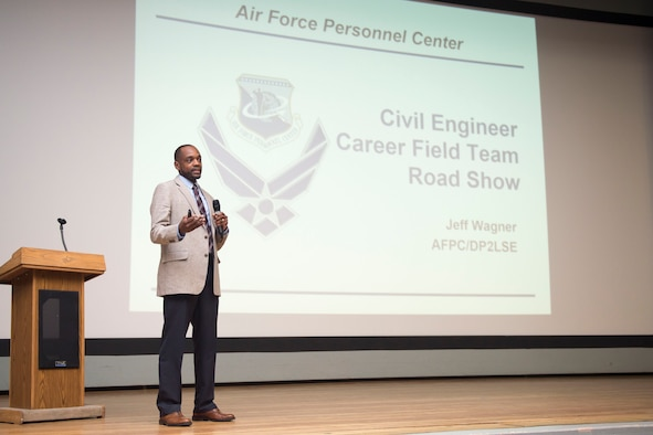 Jabuaar Rorie, Air Force Personnel Center Civil Engineer career field advisor, speaks to an audience at the base theater April 6. Rorie was part of a two-man team who visited Edwards as part of the Civil Engineer Career Field Team Road Show, which provides insight to CE personnel on career management and development. (U.S. Air Force photo by Ethan Wagner)