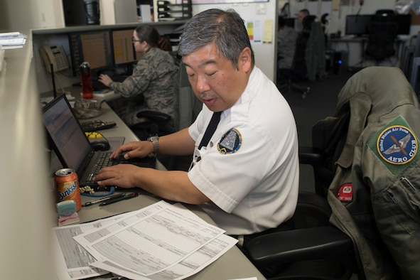 Keita Nanko, 374th Operations Support Squadron air traffic specialist, inputs flight plans at Yokota Air Base, Japan, during the Kanto Plain Mid-Air Collision and Avoidance Conference, April 15, 2017. . Twenty-five airmen and civilian volunteered to help the conference by helping coordinate tours, drivers, air marshals, check-in, briefers and flight plan checks. (U.S. Air Force photo by Yasuo Osakabe)