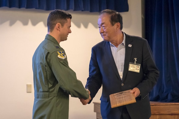 Arinori Yamagata, the Aircraft Owners and Pilots Association-Japan, shakes hands with Capt. John Menezes, 374th Airlift Wing flight safety officer, during the Kanto Plain Mid-Air Collision and Avoidance Conference, at Yokota Air Base, Japan, April 15, 2017. More than 100 private Japanese pilots participated in the conference to increase awareness and promote safety in the skies over the Yokota and the surrounding communities. (U.S. Air Force photo by Yasuo Osakabe)