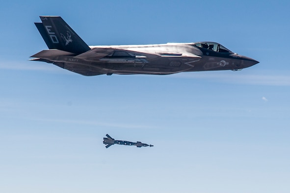 An F-35C from the 461st Flight Test Squadron at Edwards Air Force Base, California, releases a GBU-12 Paveway II guided bomb March 29. The inert bomb tracked a moving pickup truck on the ground at Naval Air Weapons Station China Lake in California. The fifth-generation fighter was flown by Col. Scott Cain, 412th Operations Group commander. (Courtesy photo by Darin Russell/Lockheed Martin)
