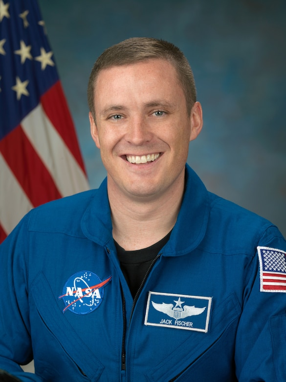 An Air Force Academy graduate will travel to the International Space Station April 20 to conduct research NASA hopes will eventually lead to a mission to Mars.
