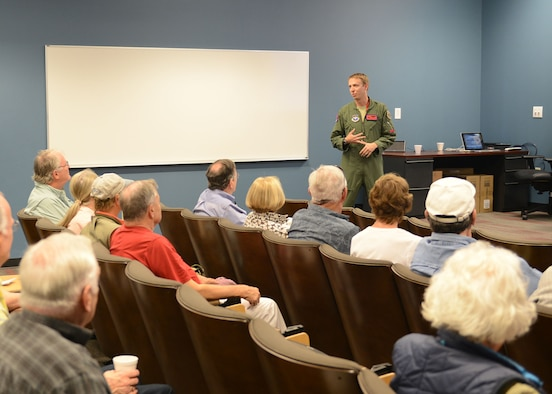Maj. Hunter Powell, 63rd Fighter Squadron F-35 Lightning II instructor pilot, gives a mission brief to the Undergraduate Pilot Training class of 1967 April 12, 2017, at Luke Air Force Base, Ariz. The group visited the squadron as part of their 50-year reunion. (U.S. Air Force photo by Senior Airman James Hensley)