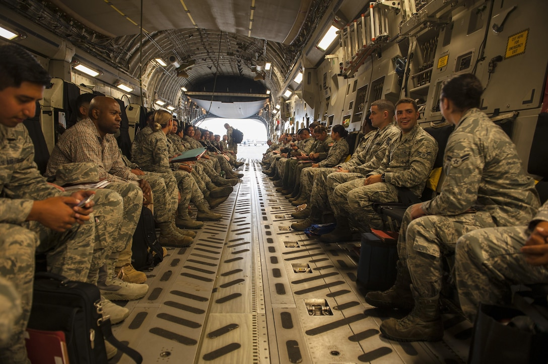 Airmen aboard a C-17 Globemaster III are headed to Wheeler Army Airfield, Hawaii for Exercise TROPIC THUNDER 2017 (XTT17), Joint Base Pearl Harbor-Hickam, Hawaii, April 19, 2017. XTT17 is a two part full spectrum readiness exercise hosted by the 15th Wing to test the individual, organizational and expeditionary readiness of the Airmen stationed at Hickam Field. (U.S. Air Force photo by Tech. Sgt. Heather Redman)
