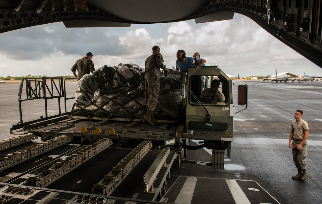 Logistics personnel work together to load cargo onto a C-17 Globemaster III during Exercise TROPIC THUNDER 2017 (XTT17), Joint Base Pearl Harbor-Hickam, Hawaii, April 19,2017. XTT17 is a two part full spectrum readiness exercise hosted by the 15th Wing to test the individual, organizational and expeditionary readiness of the Airmen stationed at Hickam Field. (U.S. Air Force photo by Tech. Sgt. Heather Redman)