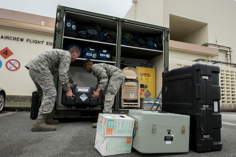 U.S. Air Force Senior Airman Joseph Gago and Airman Nigel Simpson, 18th Operations Support Squadron aircrew flight equipment technicians assigned to the 44th Fighter Squadron, stow away equipment April 18, 2017, at Kadena Air Base, Japan. The AFE team prepares members of the 44th FS to participate in aviation training relocation programs in different parts of the world, such as Guam. (U.S. Air Force photo by Senior Airman John Linzmeier)