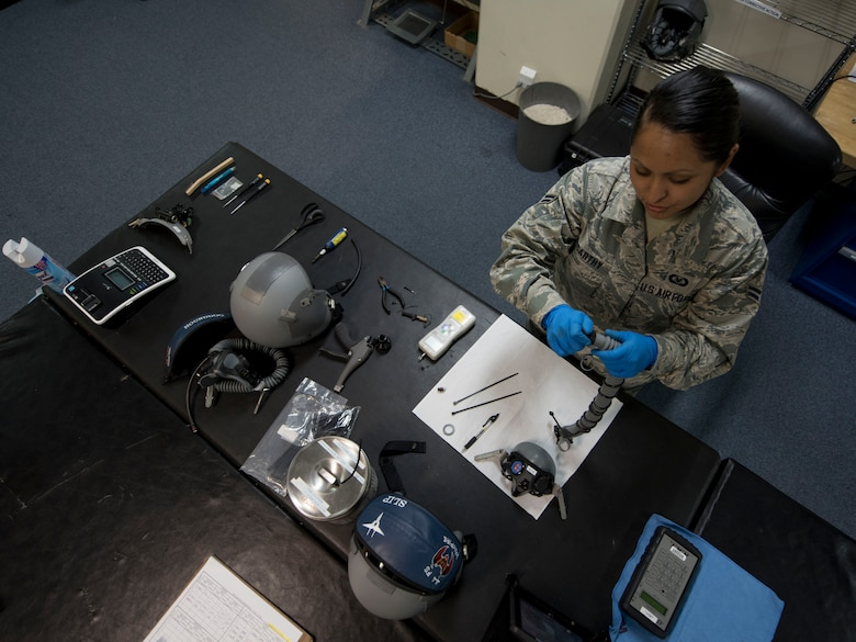 U.S. Air Force Airman 1st Class Denise McCarthy, 18th Operations Support Squadron aircrew flight equipment technician assigned to the 44th Fighter Squadron, reassembles a flight helmet April 18, 2017, at Kadena Air Base, Japan. Aircrew flight equipment is routinely broken down and put back together in order to ensure all components function properly. (U.S. Air Force photo by Senior Airman John Linzmeier)