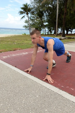 2nd Lt. Ryan Novack, 36th Munitions Squadron flight leader, prepares to run March 1, 2017 at Andersen Air Force Base, Guam. Novak was a victim of a serious spinal injury from dirt bike racing, resulting in him being paralyzed below the knee on both legs. After attending months of therapy, Novack has returned back to work and is currently conditioning for the Department of Defense Warrior Games this summer in Chicago, Illinois. (U.S. Air Force photo by Senior Airman Cierra Presentado/Released)