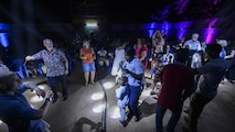 Representatives from the U.S. Embassy and local residents dance during the USAFE Band, Touch and Go, performance in Ouagadougou, Burkina Faso, April 18, 2017. The band performed a one-hour set of Top-40 hits for the local community. (U.S. Air Force photo by Staff Sgt. Jonathan Snyder)