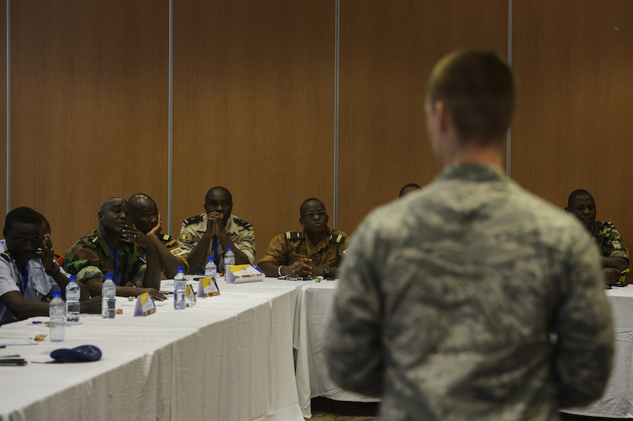 U.S. Air Force Capt. Ian Mazerski, 321st Contingency Response Squadron maintenance flight commander, speaks to African Partnership Flight participants during classroom discussion in Ouagadougou, Burkina Faso, April 18, 2017. The intent of APF is to build strong transparent partnerships that enhance regional stability and security through formal alliances, partnerships or simple exchanges of information. (U.S. Air Force photo by Staff Sgt. Jonathan Snyder)
