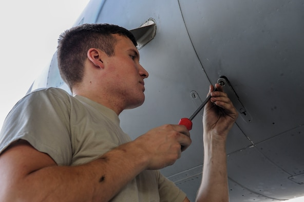U.S. Air Force Airman 1st Class Quentin Freeman, 44th Aircraft Maintenance Unit crew chief, secures a panel on an F-15 Eagle April 19, 2017, at Kadena Air Base, Japan. The 44th AMU assists the 44th Fighter Squadron with preparations for realistic training and exercises, such as Exercise Vigilant Ace. (U.S. Air Force photo by Senior Airman Lynette M. Rolen)