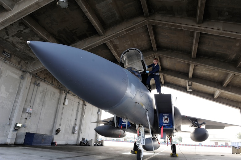 U.S. Air Force Airman 1st Class Locke Williams, 44th Aircraft Maintenance Unit crew chief, prepares an F-15 Eagle for flight April 19, 2017, at Kadena Air Base, Japan. Crew chiefs play a vital role in ensuring aircraft are ready for flight and pre-flight inspections by the pilot. (U.S. Air Force photo by Senior Airman Lynette M. Rolen)
