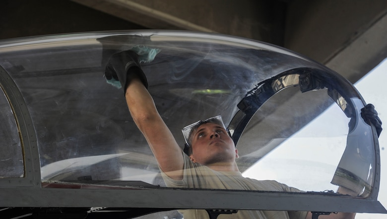 U.S. Air Force Airman 1st Class Quentin Freeman, 44th Aircraft Maintenance Unit crew chief, prepares the cockpit of an F-15 Eagle for flight April 19, 2017, at Kadena Air Base, Japan. Crew chiefs ensure pilots have optimum visibility when piloting their aircraft. (U.S. Air Force photo by Senior Airman Lynette M. Rolen)