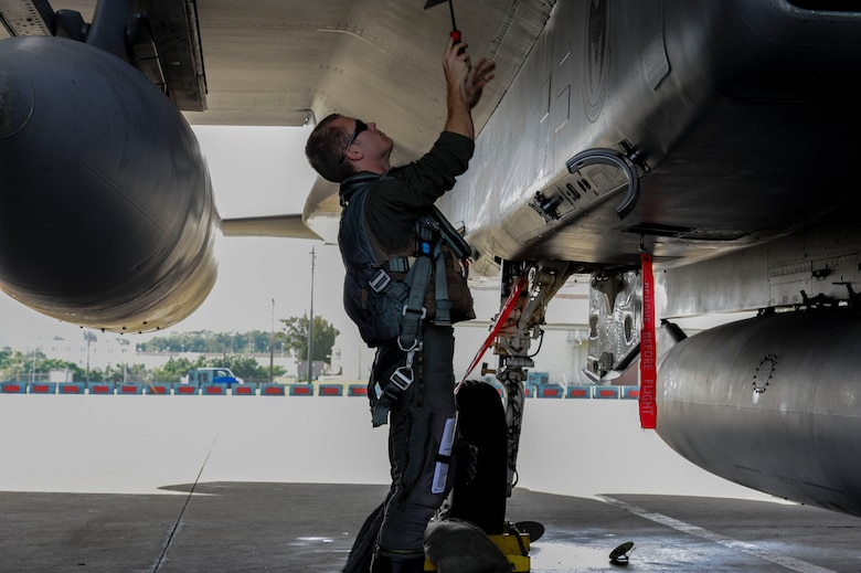U.S. Air Force 1st Lt. Austin Hurley, 44th Fighter Squadron pilot, performs pre-flight checks on an F-15 Eagle April 19, 2017, at Kadena Air Base, Japan. Pilots inspect their aircraft to make sure it will be safe to operate and carry out the mission. (U.S. Air Force photo by Senior Airman Lynette M. Rolen)