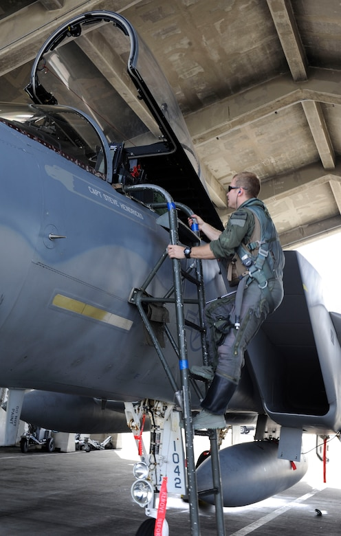 U.S. Air Force 1st Lt. Austin Hurley, 44th Fighter Squadron pilot, climbs up to the cockpit of an F-15 Eagle April 19, 2017, at Kadena Air Base, Japan. The 44th FS participates in multiple exercises throughout each year, maintaining partnerships with neighboring nations as well as peace and stability in the Pacific region. (U.S. Air Force photo by Senior Airman Lynette M. Rolen)