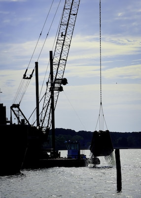 Contractors dredge a river during construction preparations for a new pier, which is used to receive jet fuel, at Joint Base Langley-Eustis, Va., April 17, 2017. The 733rd Logistics Readiness Squadron Fuels Facilities is overseeing the construction of the new pier, which, is expected to be completed in 18 months. (U.S. Air Force photo/Staff Sgt. Areca T. Bell)