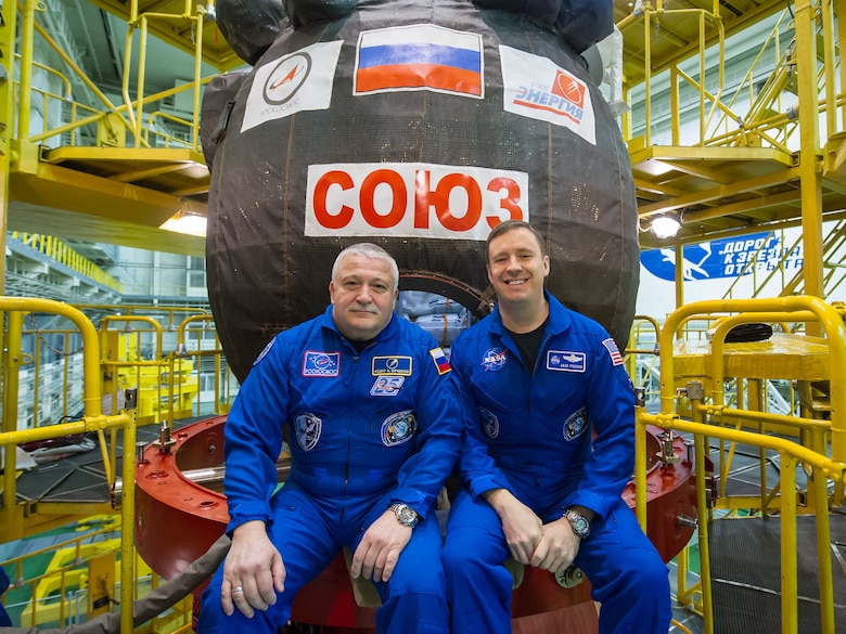 In the Integration Building at the Baikonur Cosmodrome in Kazakhstan, Expedition 51 crewmembers Fyodor Yurchikhin of the Russian space agency Roscosmos and Jack Fischer of NASA sit for pictures April 6, 2017, in front of their Soyuz MS-04 spacecraft as part of pre-launch preparations.