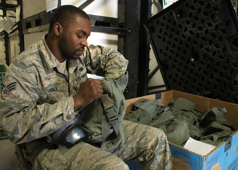 Senior Airman Antonio Jones, a 386th Expeditionary Logistics Readiness Squadron mobility technician, inventories gas masks at an undisclosed location in Southwest Asia April 7, 2017. Jones is part of the 386th ELRS expeditionary theater distribution center and is responsible for inspecting equipment and then issuing it to forward deployers. (U.S. Air Force photo/Staff Sgt. Andrew Park)