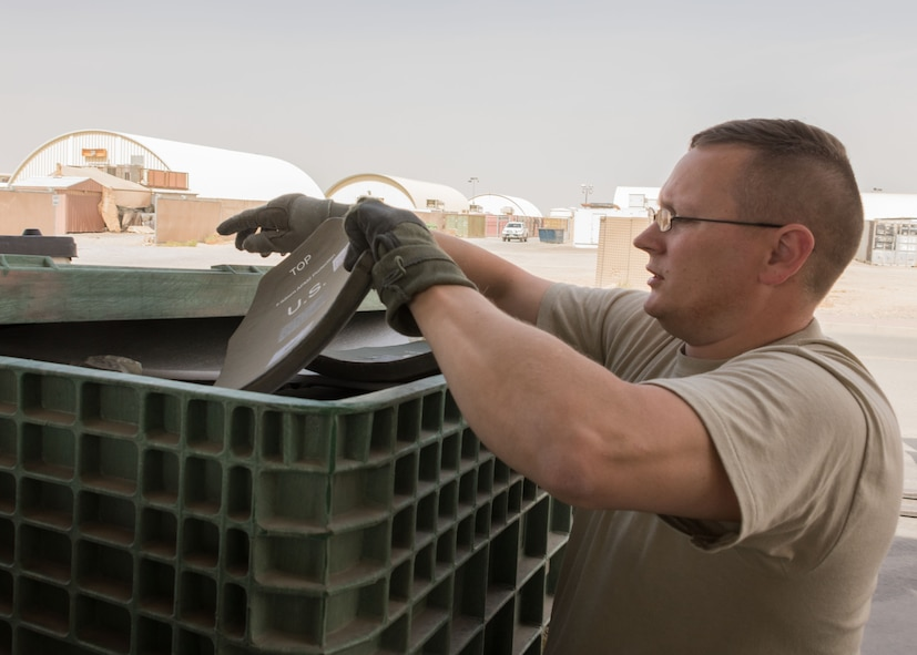 Master Sgt. Brian Donato, a 386th Expeditionary Logistics Readiness Squadron expeditionary theater distribution center section chief, explains the process for inspecting plates used in improved outer tactical vests at an undisclosed location in Southwest Asia April 19, 2017. When plates are returned to the ETDC they are sent off to be x-ray inspected for defects to ensure they are safe for reissue. (U.S. Air Force photo/Staff Sgt. Andrew Park)