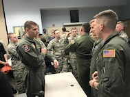 Cadet Bryan Reginald, a member of Kent State Reserve Officer Training Corp Detachment 630, talks with 1st Lt. John Kirin and 1st Lt. David Post, 757th Airlift Squadron navigators, during the ROTC Career Day April 6, 2017, at Kent State University. Several 910th Airlift Wing members participated to represent Air Force Reserve career options to the cadets. (Courtesy photo/Cadet Denise Nemeth, KSU ROTC)