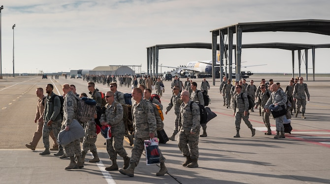 A mass of airmen returning from a deployment to Southwest Asia walk the flightline at Mountain Home Air Force Base, Idaho, April 12, 2017. After several hours on a passenger aircraft, the airmen refused the buses that had been sent out to pick them up, preferring instead to walk the short distance to their awaiting family members who were assembled in a nearby hangar. (U.S. Air Force photo by Staff Sgt. Samuel Morse)