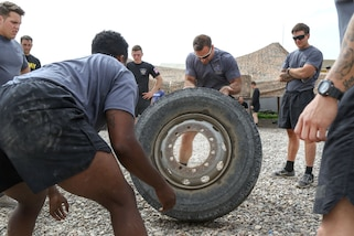 82nd Airborne Division soldiers complete in tire-flip event during a strongman competition held at a tactical assembly area near Bakhira, Iraq, April 12, 2017. Army photo by Staff Sgt. Jason Hull