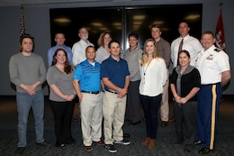 "The ""Terrific Twelve"" ERDC University participants for 2017 are pictured from left to right, Andrew Lenox, Krystle Miner, Joseph Minter, Nicholas Barkowski, Jennifer Kist, Nicole Fresard, Stephen Potts, Jeff Roberts, Sarah Spatzer, Theresa ""Tobi"" Cox, Nicholas Koutsunis and David Lattuca along with ERDC Commander Col. Bryan Green."