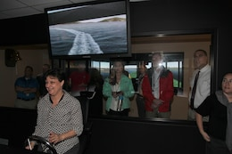 During their welcome week tour, ERDC University participants are all smiles at the Coastal and Hydraulics Laboratory's ship simulator.