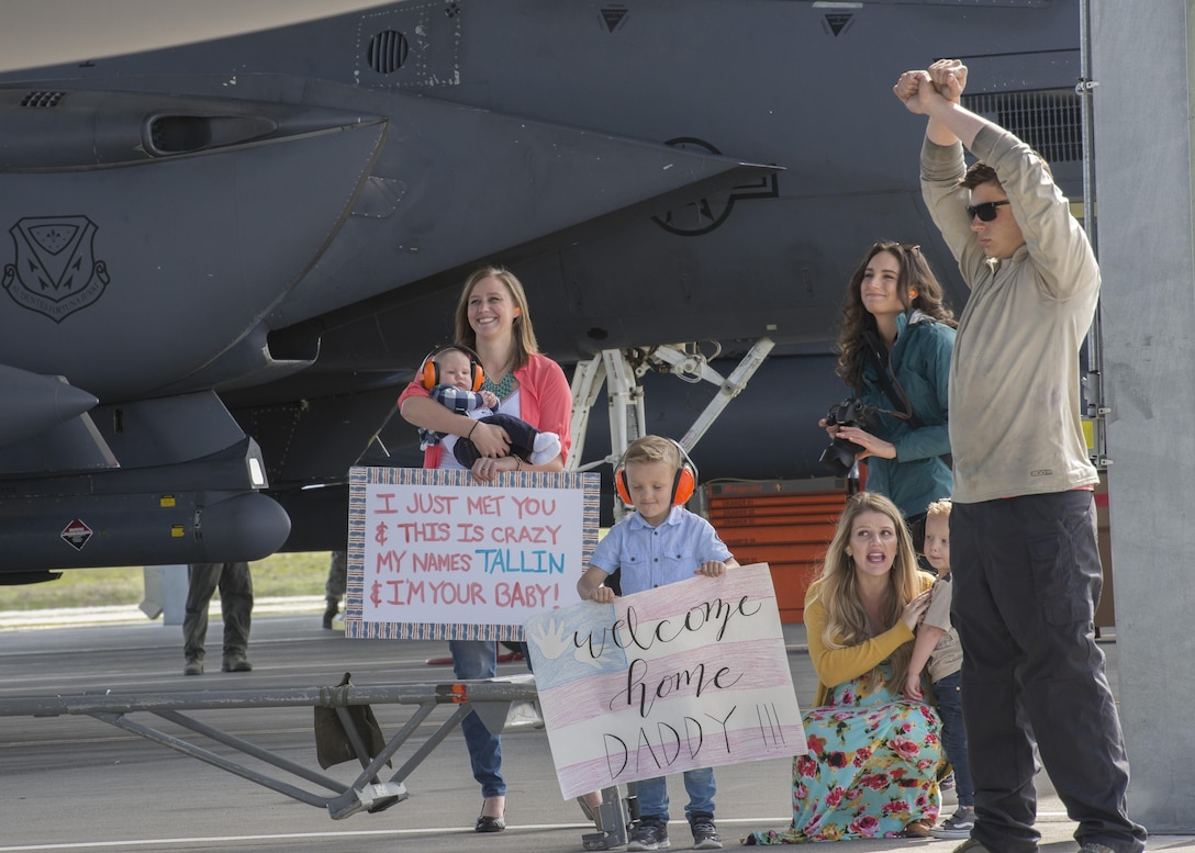 Family members wait while a crew chief directs an F-15E Strike Eagle to hold its position at Mountain Home Air Force Base, Idaho, April 8, 2017. Approximately 20 jets and 500 airmen returned that week after deploying for six months in support of Operation Inherent Resolve. (U.S. Air Force photo by Airman Jeremy D. Wolff)