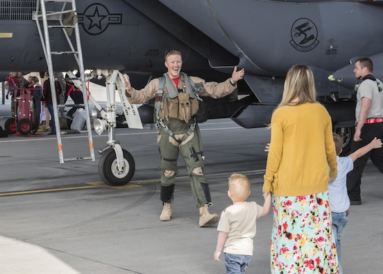 An F-15E Strike Eagle crew member greets his family for the first time in six months at Mountain Home Air Force Base, Idaho, April 8, 2017. Approximately 20 jets and 500 airmen returned that week after deploying for to Southwest Asia in support of Operation Inherent Resolve. (U.S. Air Force photo by Airman Jeremy D. Wolff)
