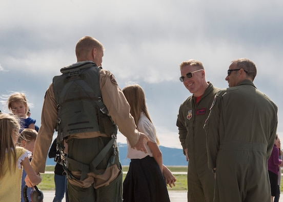 Col. Brian McCarthy (center-right), 366th Operations Group commander, welcomes home returning airmen at Mountain Home Air Force Base, Idaho, April 8, 2017. The airmen returned from a six-month deployment to Southwest Asia in support of Operation Inherent Resolve. (U.S. Air Force photo by Airman Jeremy D. Wolff)