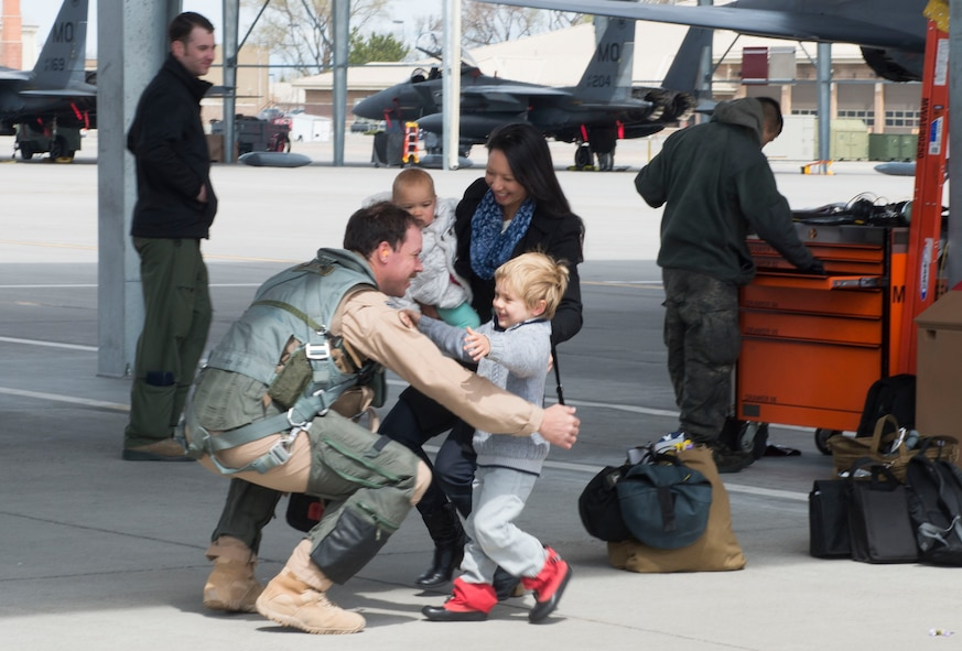 A family embraces their service member after being away for six months, April 10, 2017, at Mountain Home Air Force Base, Idaho. More than 5,000 munitions were dropped on ISIS targets in support of Air Forces Central Command. (U.S. Air Force photo by Senior Airman Malissa Lott/Released)