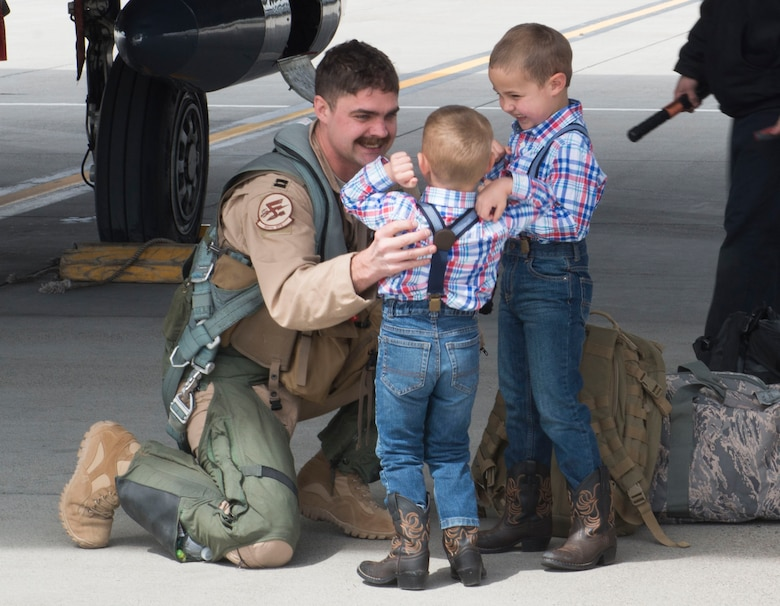 Two boys laugh with excitement over their fathers return from a six month deployment, April 10, 2017, at Mountain Home Air Force Base, Idaho. Airmen were deployed in support of Operation Inherent Resolve in Southwest Asia. (U.S. Air Force photo by Senior Airman Malissa Lott/Released)