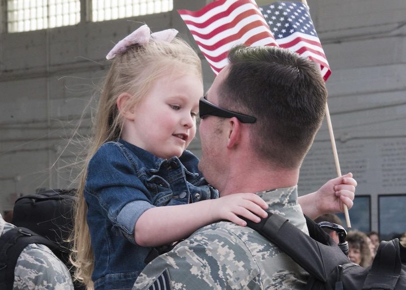 A little girl greets her dad as he returns after a six month deployment, April 12, 2017, at Mountain Home Air Force Base, Idaho. Airmen and aircraft were deployed to Southwest Asia in support of Operation Inherent Resolve. (U.S. Air Force photo by Airman Alaysia Berry/Released)