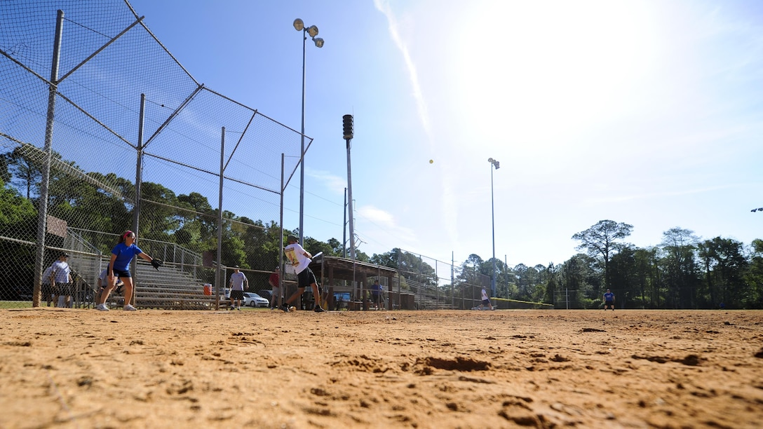 Joshua Reynolds, a third baseman with the Hurlburt Field Fire and Emergency Services softball team, hits the softball at Hurlburt Field, Fla., April 14, 2017. Reynolds participated in Battle of the Badges – a softball tournament in which police officers and firefighters from Okaloosa County and Hurlburt Field compete to be known as the 2017 Battle of the Badges champions. (U.S. Air Force photo by Airman 1st Class Dennis Spain)