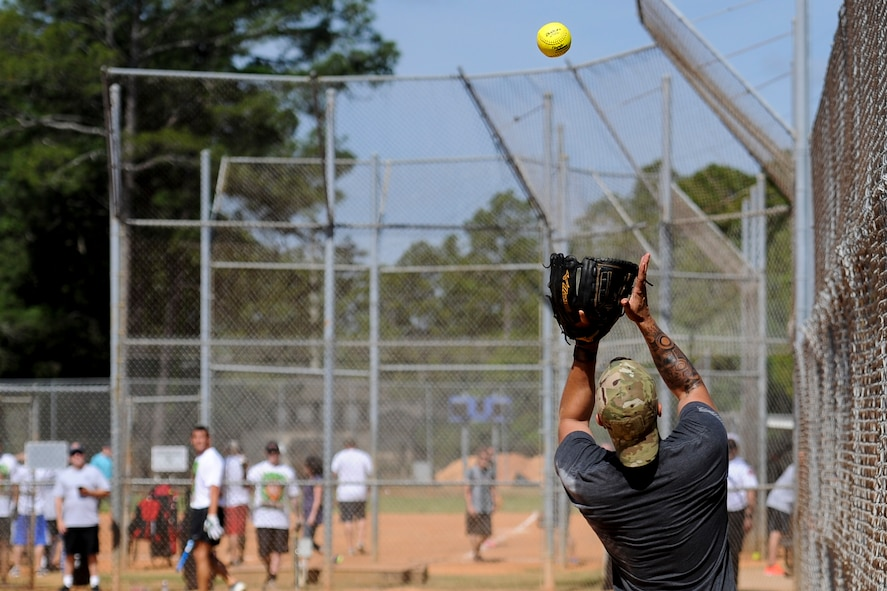 Michael Endrude, a third baseman with the 1st Special Operations Security Forces Squadron's softball team, catches a foul ball at Hurlburt Field, Fla., April 14, 2017. Endrude played during Battle of the Badges – a softball tournament in which police officers and firefighters from Okaloosa County and Hurlburt Field compete to be known as the 2017 Battle of the Badges champion.  (U.S. Air Force photo by Airman 1st Class Dennis Spain)