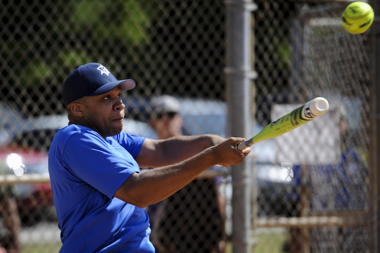 Paul Frieson, a designated hitter with the 1st Special Operations Security Forces Squadron's softball team, hits the ball at Hurlburt Field, Fla., April 14, 2017. Frieson played during Battle of the Badges – a softball tournament in which police officers and firefighters from Okaloosa County and Hurlburt Field compete to be known as the 2017 Battle of the Badges champion.  (U.S. Air Force photo by Airman 1st Class Dennis Spain)