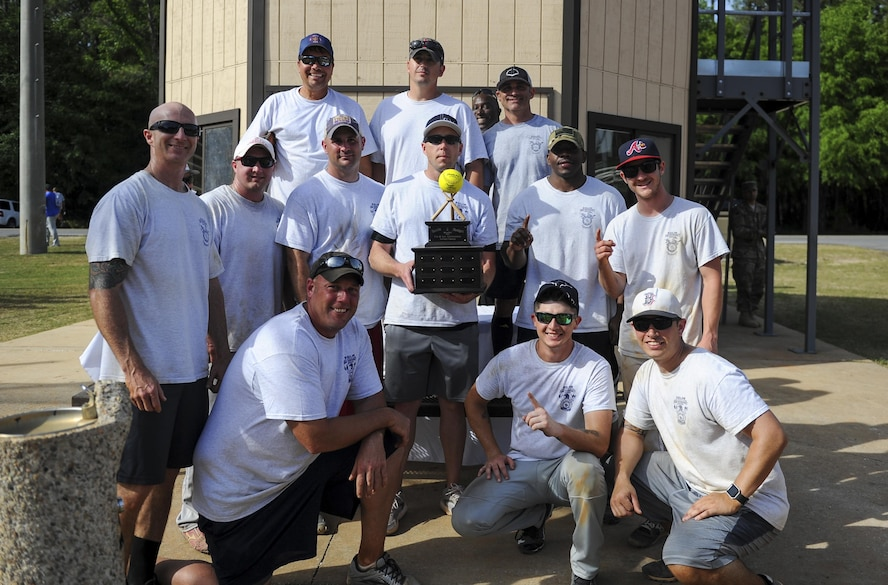 Airmen from Eglin Fire Emergency Services stand with the championship trophy after winning the Battle of the Badges softball tournament at Hurlburt Field, Fla., April 14, 2017. Eglin Fire Emergency Services won the Battle of the Badges against the 96th Security Forces Squadron with a score of 10 to 9. (U.S. Air Force photo by Airman 1st Class Isaac O. Guest IV)