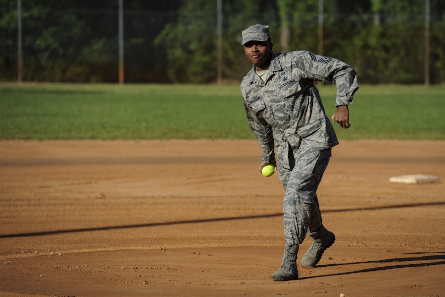 Chief Master Sgt. Robert Richardson, the superintendent of the 1st Special Operations Mission Support Group, throws the first pitch to kick off the Battle of the Badges softball tournament at Hurlburt Field, Fla., April 14, 2017. Police officers and firefighters from Hurlburt Field and Okaloosa County competed for the coveted softball championship. (U.S. Air Force photo by Airman 1st Class Dennis Spain)