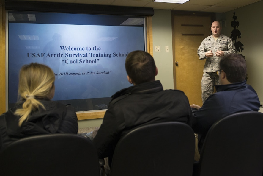 U.S. Air Force Lt. Col. William Mercer, the 66th Training Squadron detachment 1 commander, briefs Congressional staff delegates about Arctic Survival Training School (Cool School) 18 April, 2017, at Eielson Air Force Base, Alaska. Cool School teaches the fundamentals of surviving in the arctic environment, everything from building a shelter to catching and cooking food. (U.S. Air Force photo by Airman Eric M. Fisher)