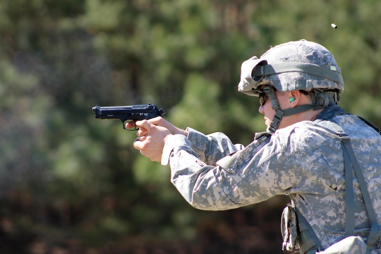Staff Sgt. Derek Roy, 29, a paralegal NCO from Danbury, Conn., fires an M-9 pistol during the USAR Legal Command Best Warrior Competition at Fort A.P. Hill Virginia.