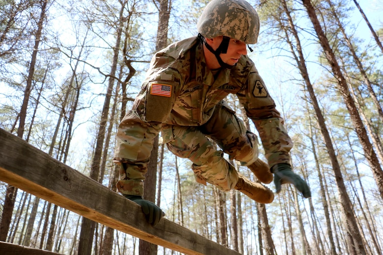 1st Lt. Justin Holloway, from the 12th Legal Operations Detachment, sails over an obstacle during the U.S. Army Reserve Legal Command's Best Warrior Competition at Fort A.P. Hill, Virginia
